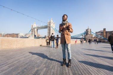 Man walking in London on Thames sidewalk