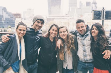 Group of friends embraced together in London.