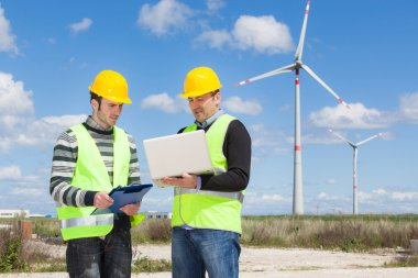 Engineers in a Wind Turbine Power Station