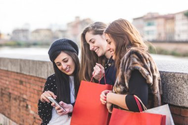Women with Smart Phone and Shopping Bags