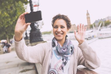 Beautiful mixed race woman taking a selfie in London