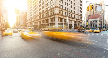 Busy road intersection in Manhattan, New York, at sunset