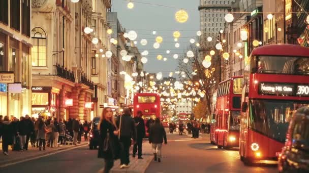 Oxford street in London with Christmas lights and traffic