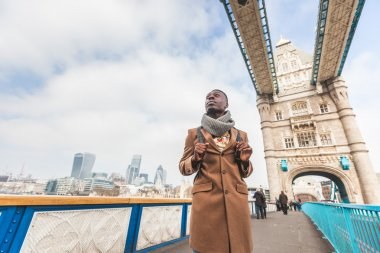 Young black man on Tower Bridge in London