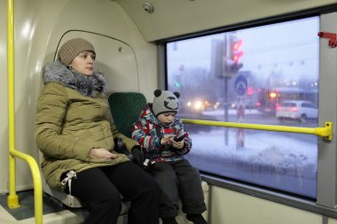 Mother and her son in the bus