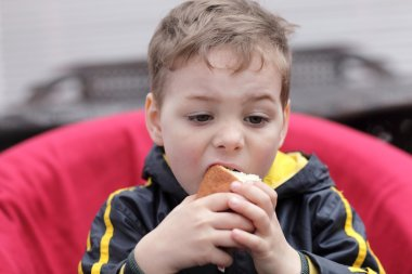Child eating bun