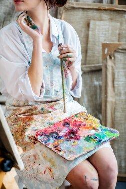 Female painter in her studio