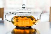Fotografie Glass teapot with tea