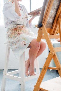 painter woman in studio
