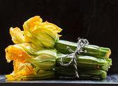 Fotografie Fresh zucchini with flowers