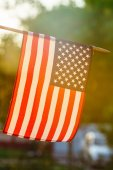 Fotografie American flag in sunny weather outdoors