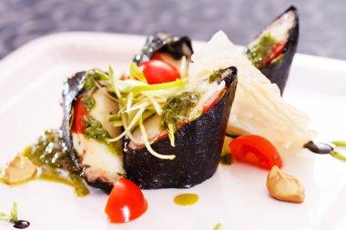 tasty sushi rolls on plate