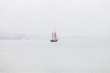 Alone sailboat in the sea