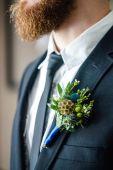 Elegant groom with flowers