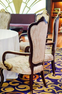 luxury wooden chairs surround table