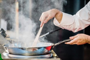 chef cooking  with pan