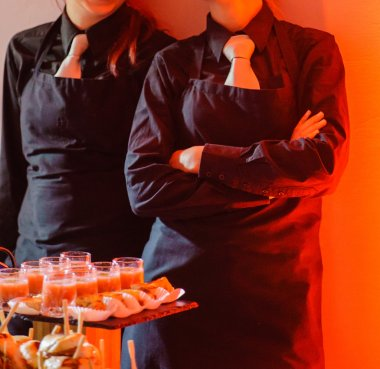 Waiters by catering table