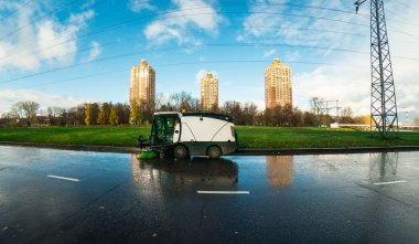 Cityscape with the street cleaning machine