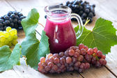 Fresh grapes and juice