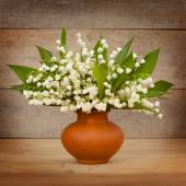 Lily of the valley in clay pot