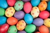 Concept holiday background. Easter eggs photographed from above