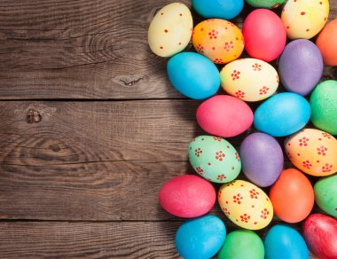 Easter eggs photographed on top of the old board