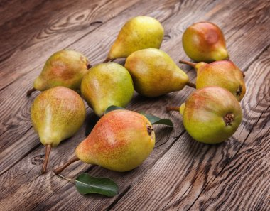 Tasty pears on the old board