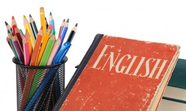 Learn English, textbook and pencils isolated