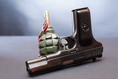 World War II Soviet equipment. Handgun near grenades on dark background stock vector