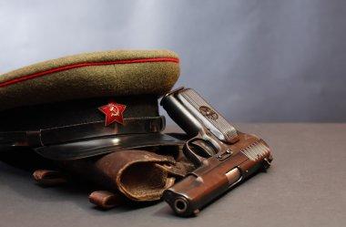 World War II Soviet officer equipment. Military cap near handgun and holster stock vector