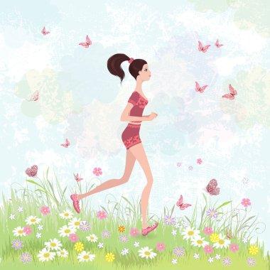Sporty brunette jogging in the park