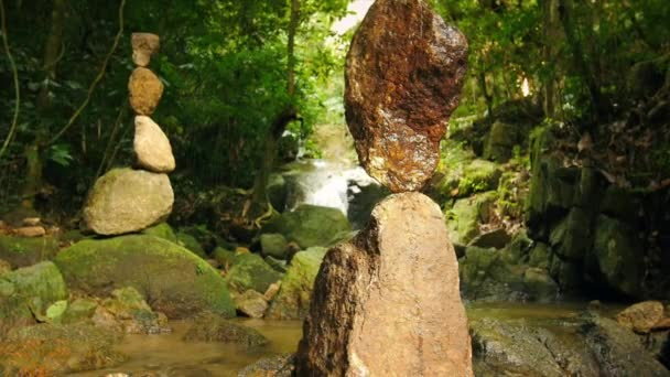 Zen meditation and relaxation nature background rock towers in tropical garden