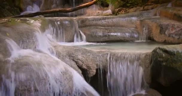 waterfall cascades in tropical rainforest