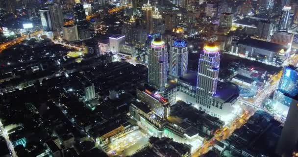 Panorama of Bangkok at night. Time lapse video of moving cars and high buildings