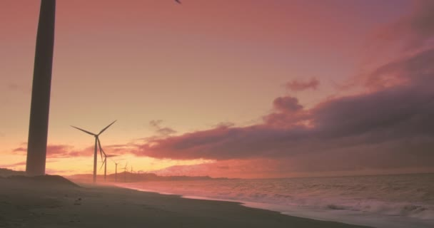Wind mills turbines at sunset