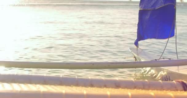 Small sailing boat at sunset