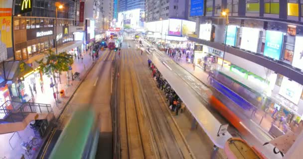 view of Hongkong transportation at night with crowds of people crossing street