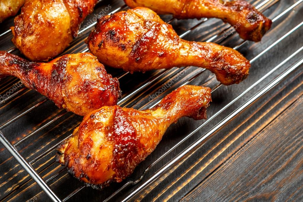 Grilled chicken legs on the grill