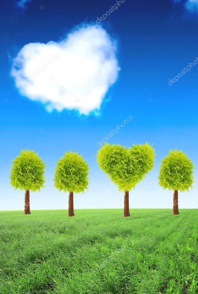 Heart shape tree on green field