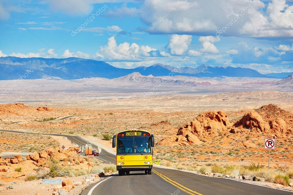 School bus driving on winding road in Valley of the Fire national park