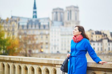 Beautiful young tourist in Paris on a fall day