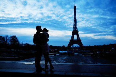 Silhouettes of romantic couple near the Eiffel tower