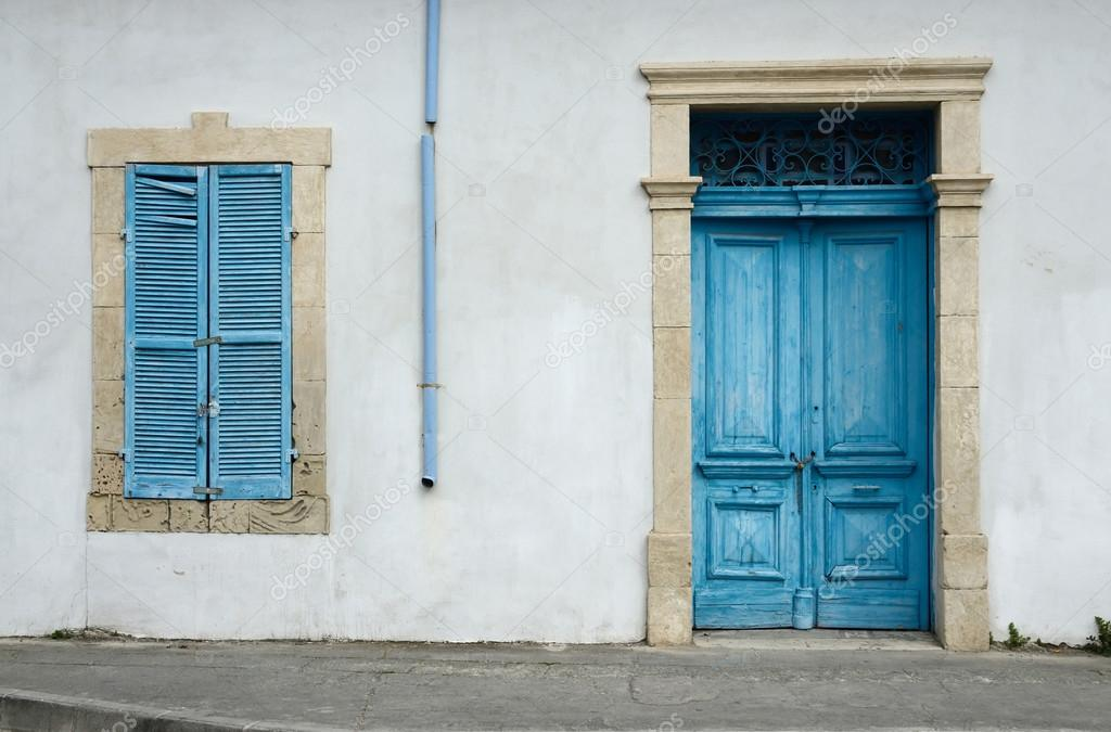 Photo of typical Cypriot old aged white building with bright blue ...