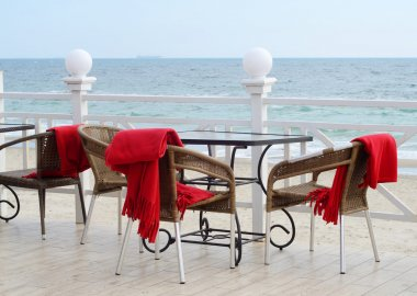 Empty tables at hotel restaurant with red plaids on Black Sea coast,Odessa outdoors