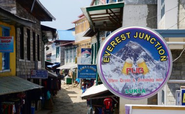 LUKLA,NEPAL - APRIL 14,2013:Street market, cafe and restaurants of Lukla city.City is  known by its one of most dangerous airports in the world - Tenzing-Hillary Airport and also as place where tourists starting Everest Base camp trek