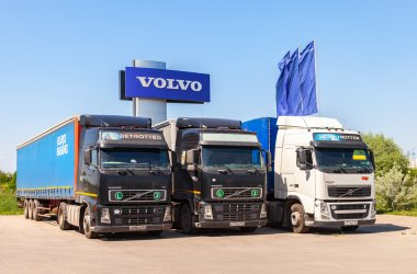 Volvo trucks parked at the service station in summer day