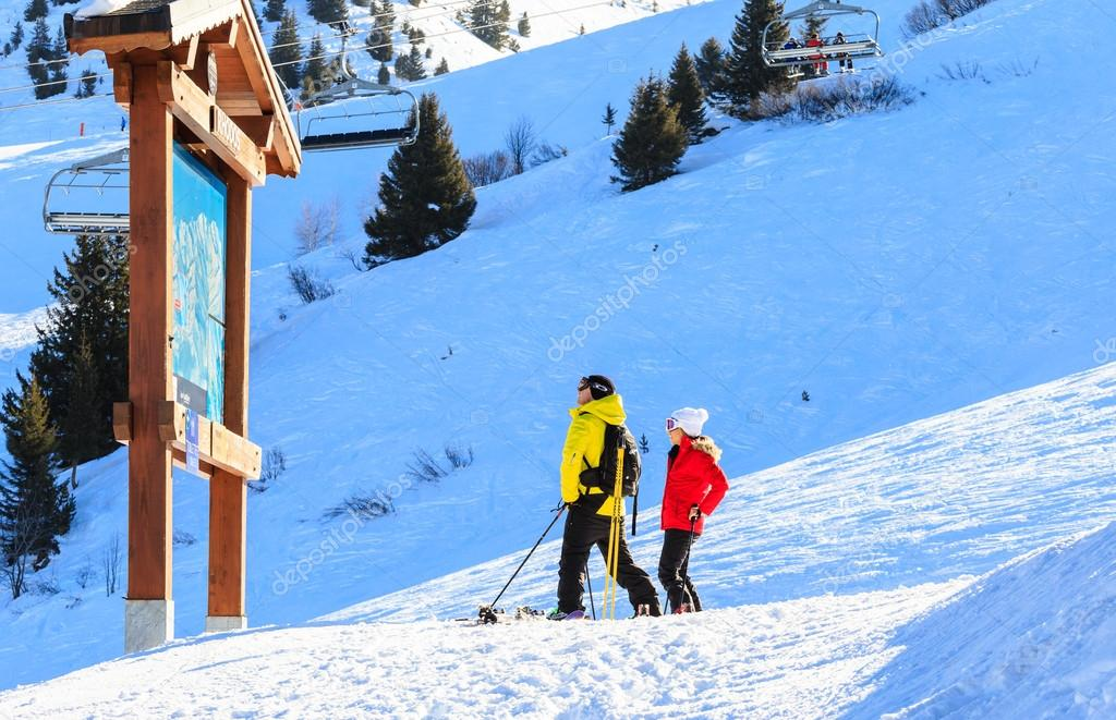 Skiers standing at the map of Meribel ski resort France Stock