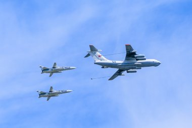 Il-78 (Midas) aerial tanker demonstrates refueling of 2 Su-24 (Fencer)