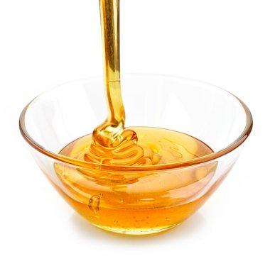 honey pouring into bowl