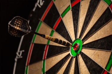 Dart in bulls eye close up